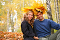 Pair With Leaves On Head In Autumn Wood Royalty Free Stock Photography - 7095097