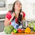 Young Woman Chef Standing Over Kettle Of Cooking Food, Pulling Her Own Hair In Frustration And Upset Facial Expression Royalty Free Stock Photography - 70922587