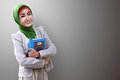 Pretty Asian Muslim Woman Holding Koran Royalty Free Stock Photo - 70923325