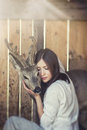 Young Beautiful Woman Hugging Animal ROE Deer In The Sunshine Stock Images - 70924384