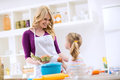 Woman Giving Egg To Daughter Royalty Free Stock Photo - 70927095