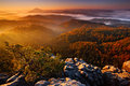 Cold Misty Foggy Morning With Sunrise In A Fall Valley Of Bohemian Switzerland Park. Hills With Fog, Landscape Of Czech Republic, Stock Photos - 70943783