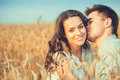 Young Couple In Love Outdoor.Stunning Sensual Outdoor Portrait Of Young Stylish Fashion Couple Posing In Summer In Field Royalty Free Stock Image - 70963276