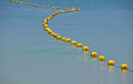 Chain Of Yellow Buoys In Blue Sea Water Stock Photos - 70964353