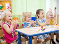 Kids Group Learning Arts And Crafts In Day Care Centre Royalty Free Stock Photo - 70976205