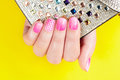 Nails With Manicure Covered With Pink Nail Polish, Yellow Background Royalty Free Stock Photo - 71049215