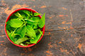 Fresh Green Nettle Leaves In A Red Bowl Stock Photo - 71049690