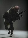 Soldier Man Hold Machine Gun On A  Dark Background Royalty Free Stock Photos - 71057218