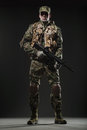 Soldier Man Hold Machine Gun On A  Dark Background Royalty Free Stock Image - 71058016