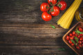 Food Background: Dry Pasta, Tomatoes, Olive Oil And Spices Royalty Free Stock Photos - 71065028