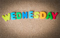 Colorful Wooden Word WEDNESDAY On Cork Board With Selective Focus Stock Images - 71069694