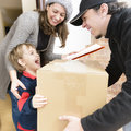 Courier Delivering A Package Royalty Free Stock Photography - 71089767