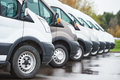 Transporting Service Company. Commercial Delivery Vans In Row Stock Photo - 71142460