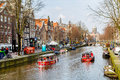 Cruise Boat At Amsterdam Canals In Holland, Street View Royalty Free Stock Photos - 71145158