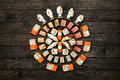 Set Of Sushi Maki And Rolls At Black Rustic Wood. Stock Photo - 71147430