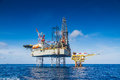 Oil And Gas Drilling Rig Work Over Remote Wellhead Platform To Completion Oil And Gas Produce Well Royalty Free Stock Photography - 71177607