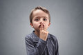 Shh Boy With Finger On Lips Stock Images - 71189544