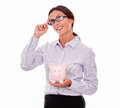 Thinking Businesswoman With Pink Piggy Bank Stock Images - 71196214
