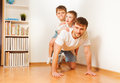 Father Giving His Two Sons Piggy Back Ride Royalty Free Stock Photos - 71201498