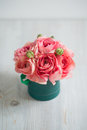 Bunch Of Pale Pink Ranunculus Persian Buttercup  Light Background, Wooden Surface. Green Box Stock Image - 71209941