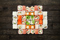 Set Of Sushi Maki And Rolls At Black Rustic Wood. Royalty Free Stock Photos - 71210468