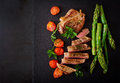 Juicy Steak Medium Rare Beef With Spices And Tomatoes, Asparagus. Stock Image - 71214101