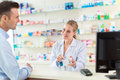 Pharmacist And Client At Pharmacy Royalty Free Stock Image - 71227126