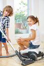 Siblings Cleaning Home With Vacuum Cleaner Royalty Free Stock Photo - 71281145