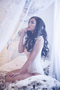 Beautiful Girl On The Bed In Feathers Room Stock Photography - 71296012