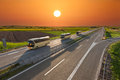 Fast Travel Buses In A Row On The Highway At Sunset Stock Photography - 71301122