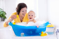 Young Mother Bathing Baby Boy Royalty Free Stock Photography - 71324347