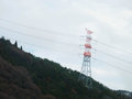 White And Red Painted Power Pole On The Mountain Forest Stock Photos - 71326423