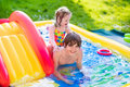 Kids Playing In Inflatable Pool Royalty Free Stock Photo - 71326485