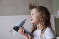 Baby Little Girl Dries Hair, Sisters Taking Care Of Yourself, Th Royalty Free Stock Photo - 71330715