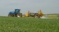Blue Modern Tractor Pulling A Crop Sprayer Royalty Free Stock Photos - 71331198