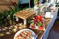 Buffet Table Full Of Food In Small Dishes And A Fruit Platter. Stock Photography - 71405332