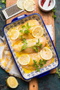 Lemon Chicken Breast Preparation. Baking Dish With Lemon Chicken On Kitchen Table With Ingredients And Cooking Tools, Top View Stock Images - 71420604