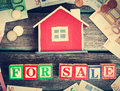 Red House On Wooden Background With Banknotes Royalty Free Stock Image - 71420866