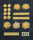 Different Types Of Italian Uncooked Pasta On Black Slate Stone Background, Top View Royalty Free Stock Image - 71441456