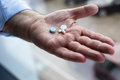 Old Hand Holding Pills Stock Photo - 71441790