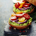 Tasty Homemade Sandwiches With Avocado, Tomato, Onion And Pepper Royalty Free Stock Photos - 71442638