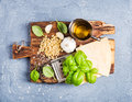 Ingredients For Cooking Pesto Sauce. Parmesan Cheese, Metal Grater, Fresh Basil, Olive Oil, Garlic And Pine Nuts On Old Royalty Free Stock Photo - 71444965