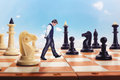 Businessman On The Chess Board Stock Photo - 71451610