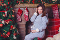 Closeup Photo Of Pregnant Woman Posing Against Fireplace And Christmas Tree Royalty Free Stock Photo - 71456165