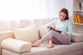 Positive Woman Resting On The Couch Royalty Free Stock Photos - 71462578