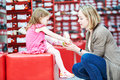 Family Shopping Choosing Child Footwear Shoes Stock Image - 71474201