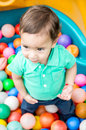 Adorable Baby Boy Wearing Turquoise T-shirt Playing With Colored Plastic Balls Shot From Above Angle Royalty Free Stock Photography - 71479087