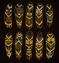 Hand Drawn Golden Ethnic Feathers Set Isolated On Brown Background. Collection Of Stylized Tribal Elements. Royalty Free Stock Photography - 71513247
