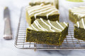 Matcha Green Tea Brownie Cake With White Chocolate On A Cooling Rack Grey Stone Background Royalty Free Stock Images - 71517629