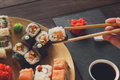 Set Of Sushi Maki And Rolls At Black Rustic Wood. Royalty Free Stock Photos - 71521198